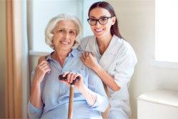 caretaker assisting her patient